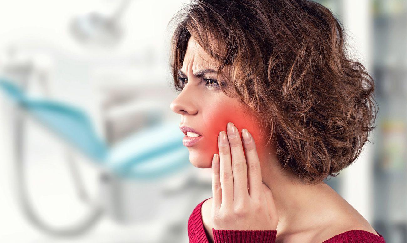 После удаления зуба мудрости болят передние зубы