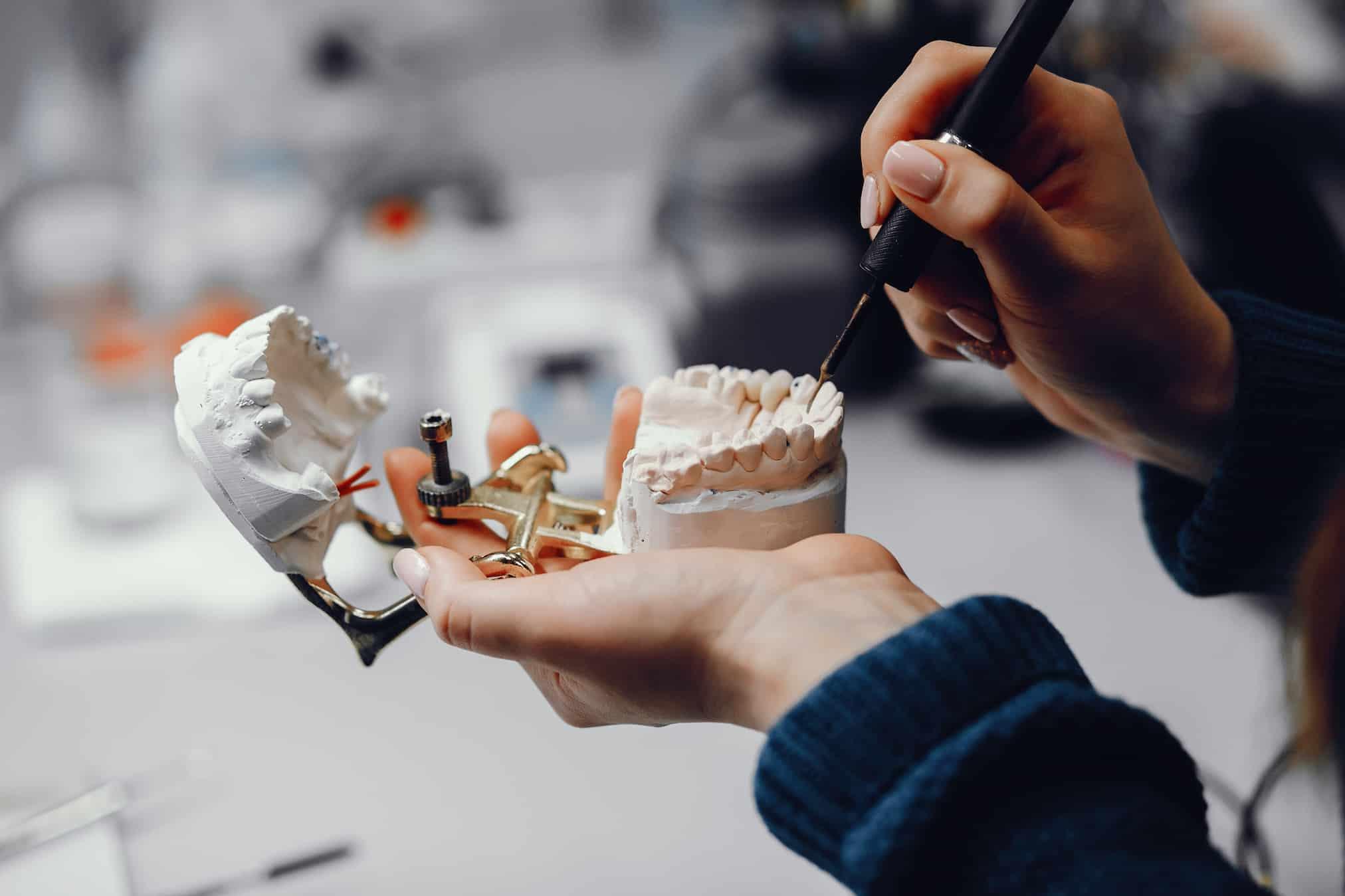 Ремонт зубного протеза