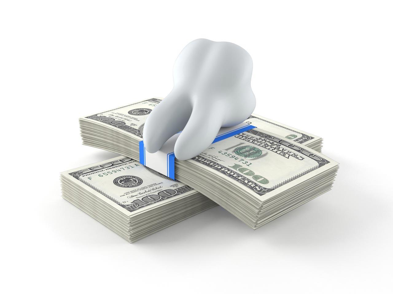Зуб на деньгах